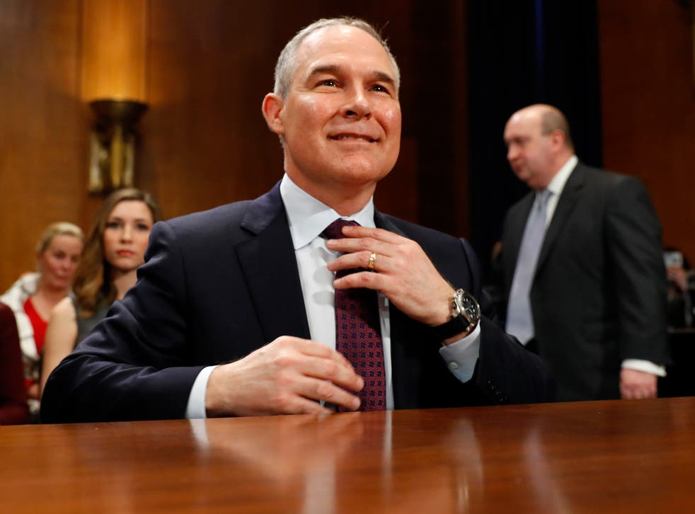 Pruitt arrives at his confirmation hearing before the Senate Committee on Environment and Public Works yesterday