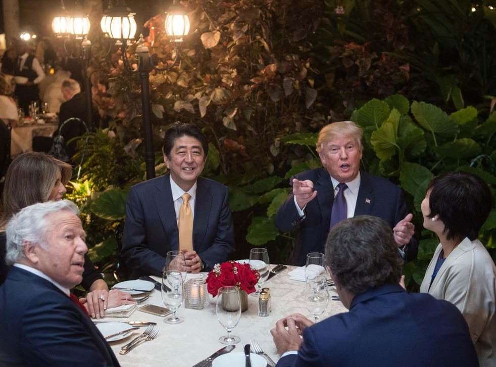 Donald Trump, with Japan Prime Minister Shinzo Abe, his wife, Melania Trump, and New England Patriots owner Robert Kraft, in Mar-a-Lago