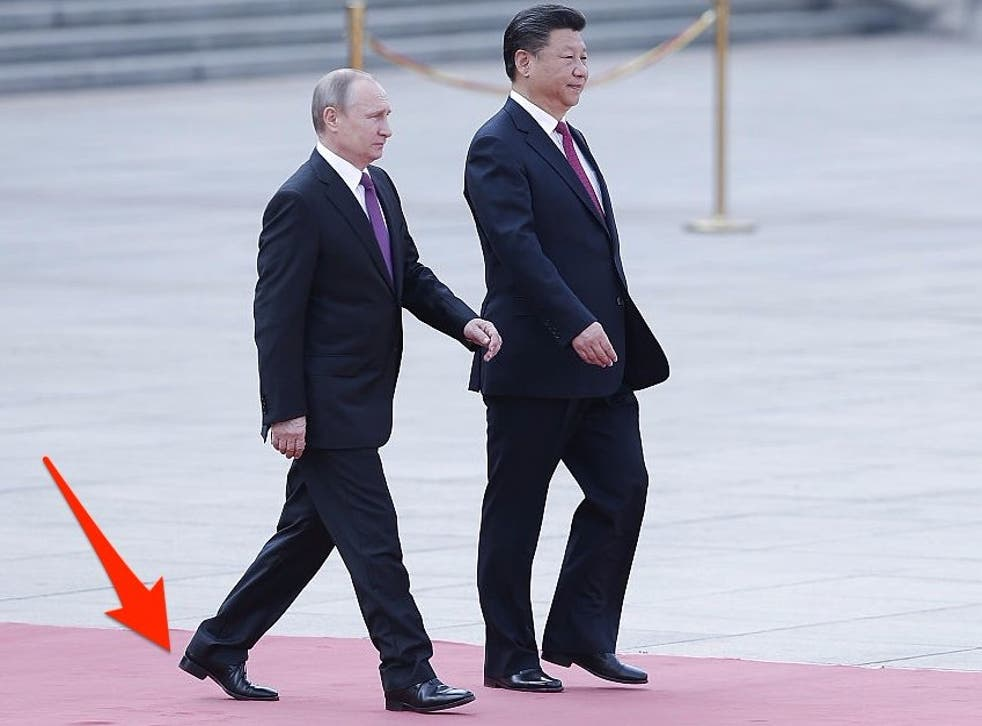Vladimir Putin wearing shoes with a large heel