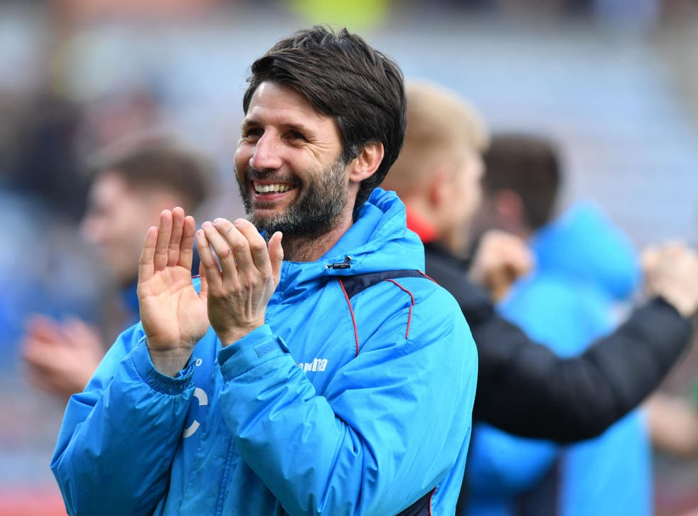 Cowley celebrates after watching his side defeat Burnley 1-0