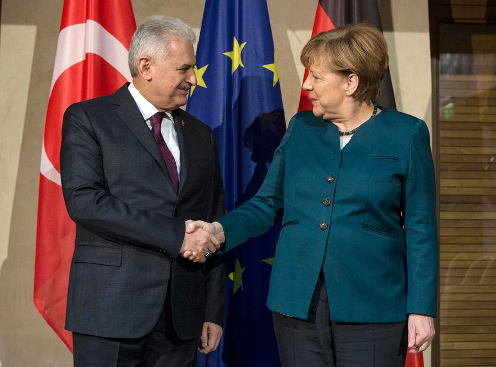 German Chancellor Angela Merkel with Turkish Prime Minister Binali Yildirim prior to a bilateral meeting during the 53rd Munich Security Conference on 18 February