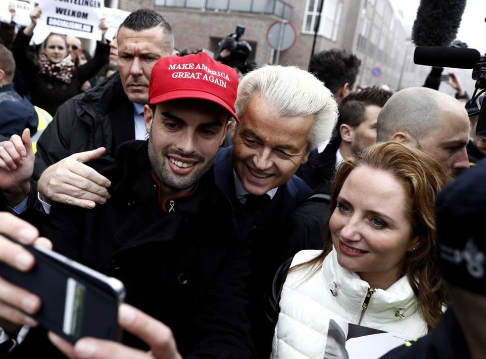 Dutch politician Geert Wilders with a supporter wearing a pro-Donald Trump hat in Spijkenisse