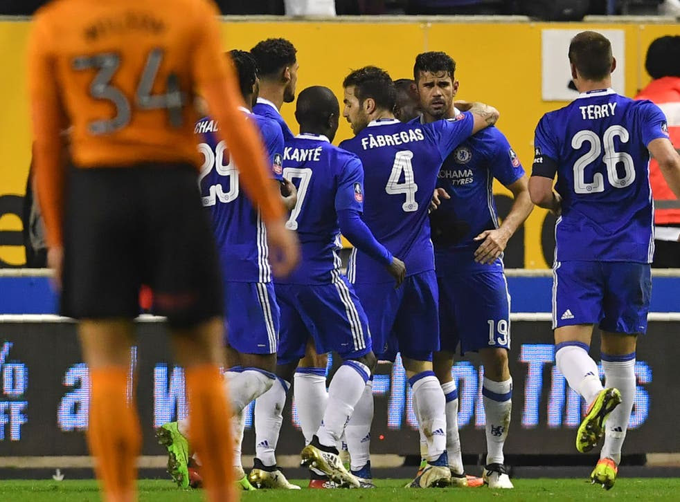 Costa is congratulated by his team-mates after scoring Chelsea's second