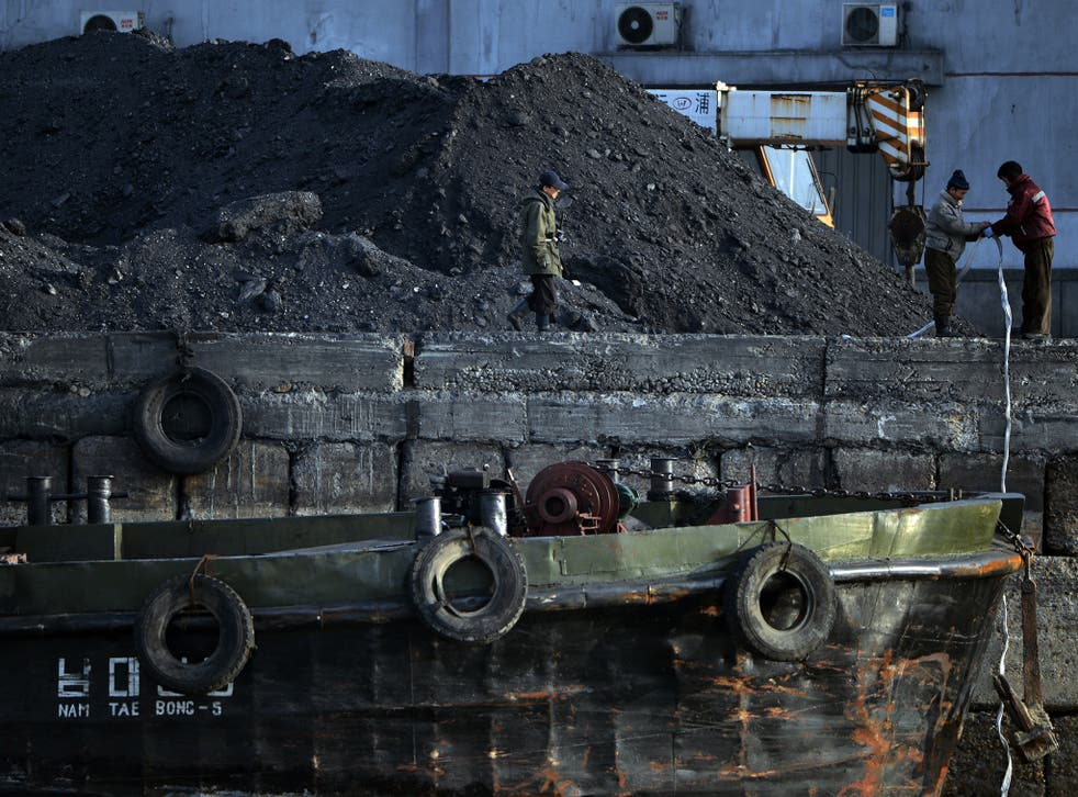 North Korean labourers working with coal near the Chinese border in 2013