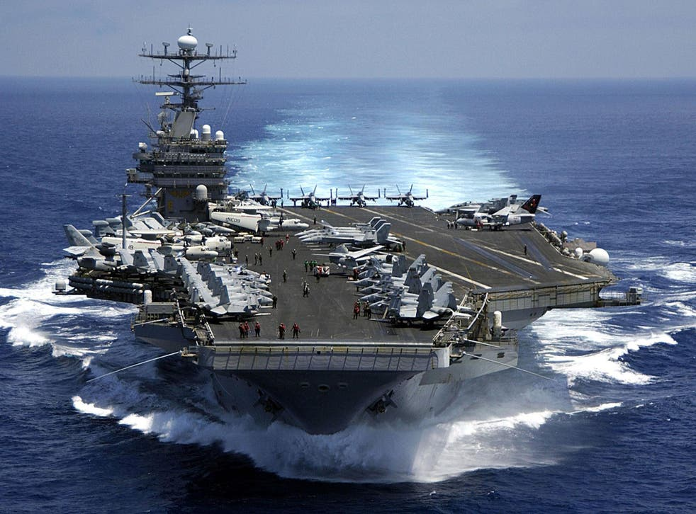 US Navy says the force, which includes the Nimitz-class aircraft carrier USS Carl Vinson and a fleet of supporting warships, has begun 'routine operations' in disputed waterway