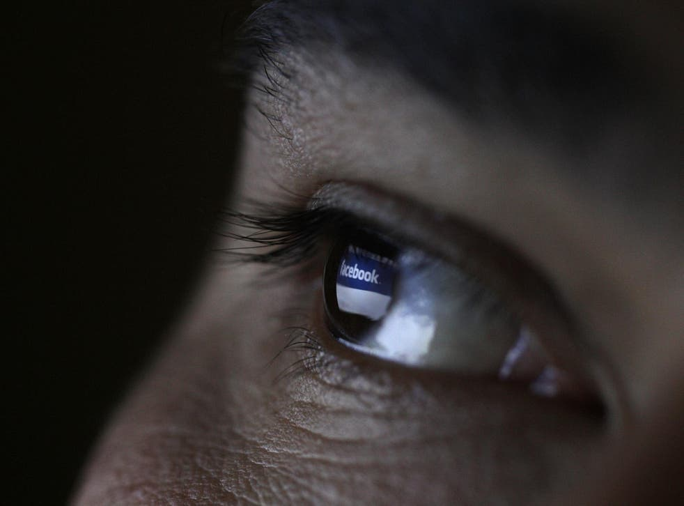 A picture illustration shows a man looking at the Facebook website on a tablet in Sofia June 27, 2012