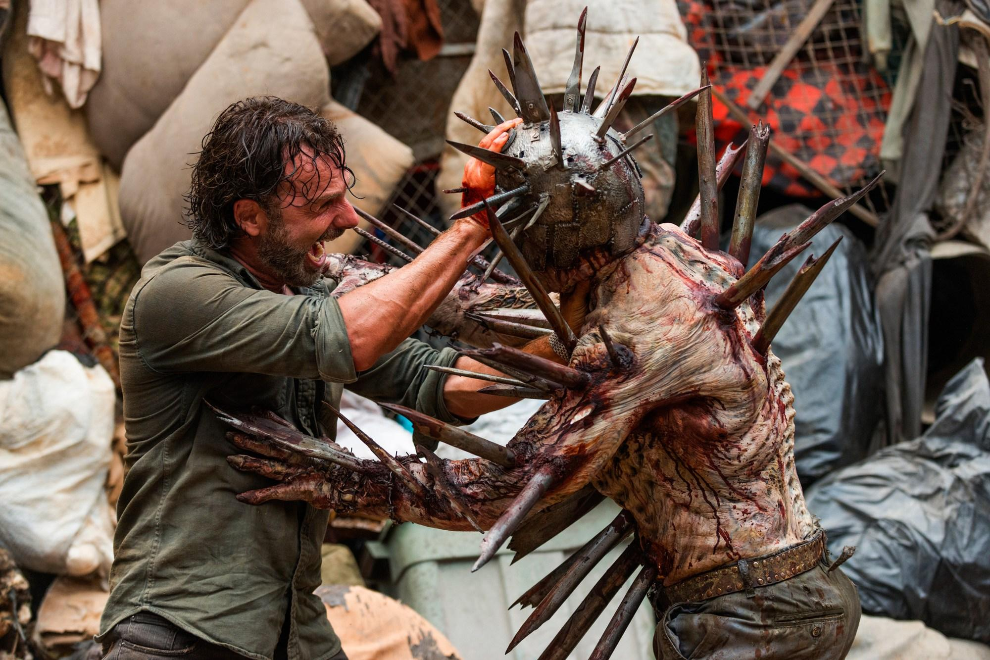 The Walking Dead season 7 episode 10: Watch Rick fight the most insane zombie ever in 'New Best Friends' | The Independent