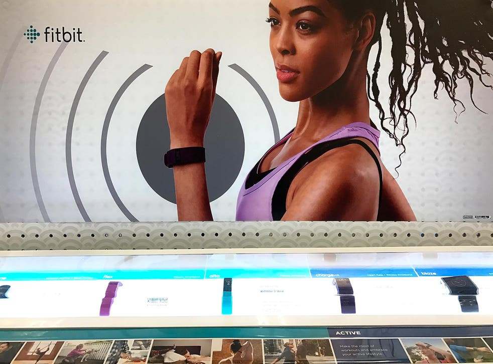 Fitbit fitness trackers are displayed on a shelf at a Target store on January 30, 2017 in Los Angeles, California