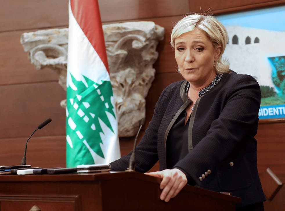 The French far-right leader speaks during a press conference at the presidential palace in Lebanon