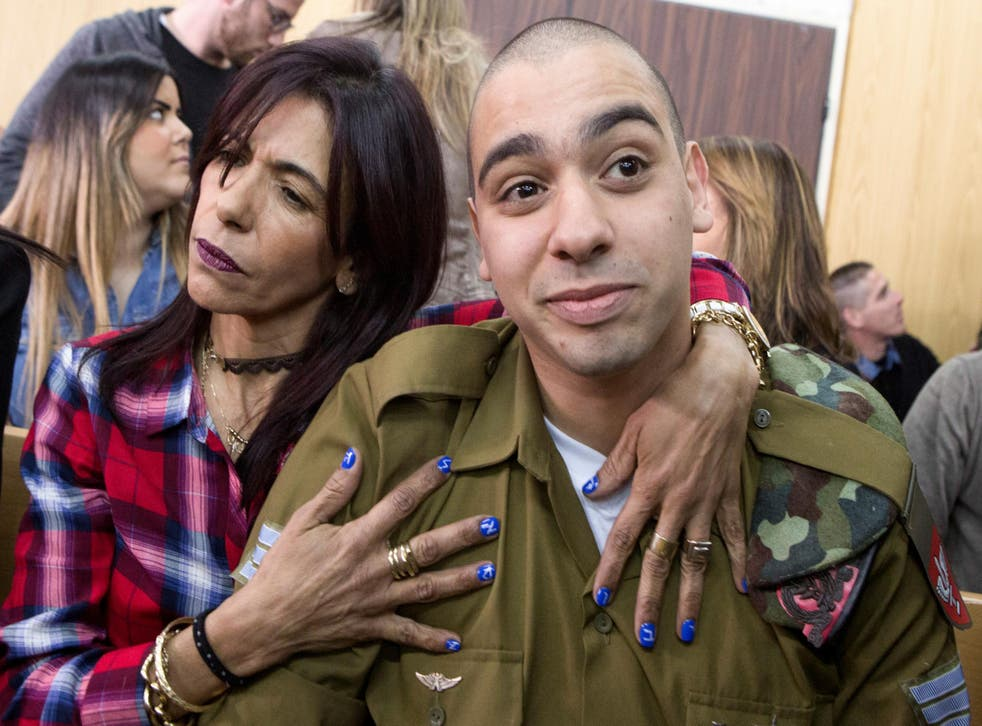 Israeli soldier Elor Azaria is embraced by his mother at the start of is sentencing hearing at a military court in Tel Aviv, Israel on February 21, 2017