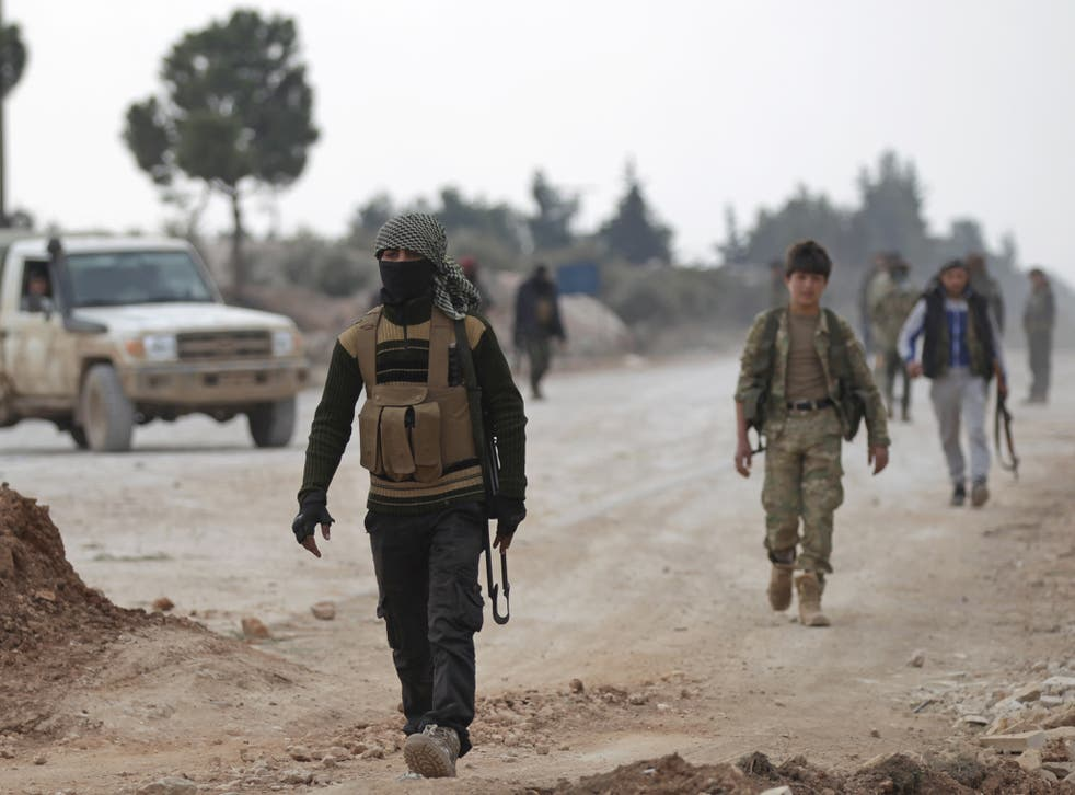 Free Syrian Army fighters on the outskirts of the Isis-controlled northern Syrian town of al-Bab