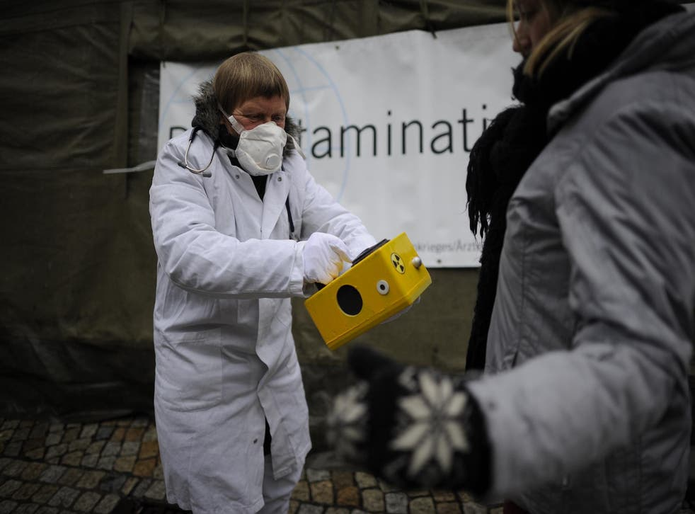 Anti-Nuclear protesters use a Geiger counter to measure the radioactive contamination of a citizen on March 9, 2013 in Hildesheim, Germany