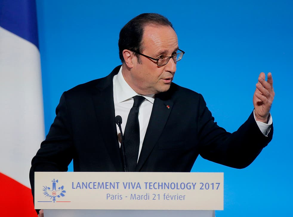 France's President Francois Hollande gestures as he speaks during the global tech conference Viva Technology in Paris at the Elysee Palace in Paris