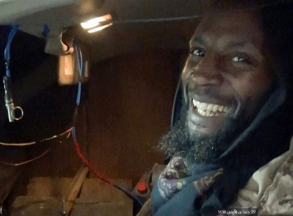 The terror group's Amaq news agency released a picture of a grinning al-Britani sat in his explosives-laden vehicle