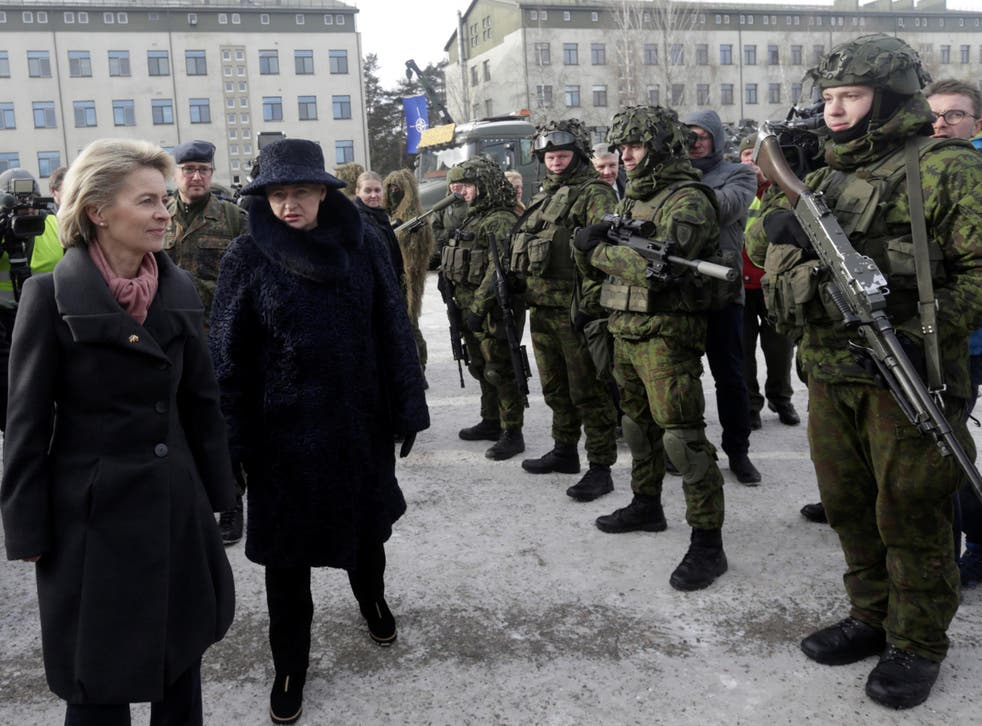 German Defence Minister Ursula von der Leyen and Lithuania's President Dalia Grybauskaite attend a ceremony to welcome the German battalion being deployed to Lithuania as part of Nato deterrence measures against Russia in Rukla on February 7 2017