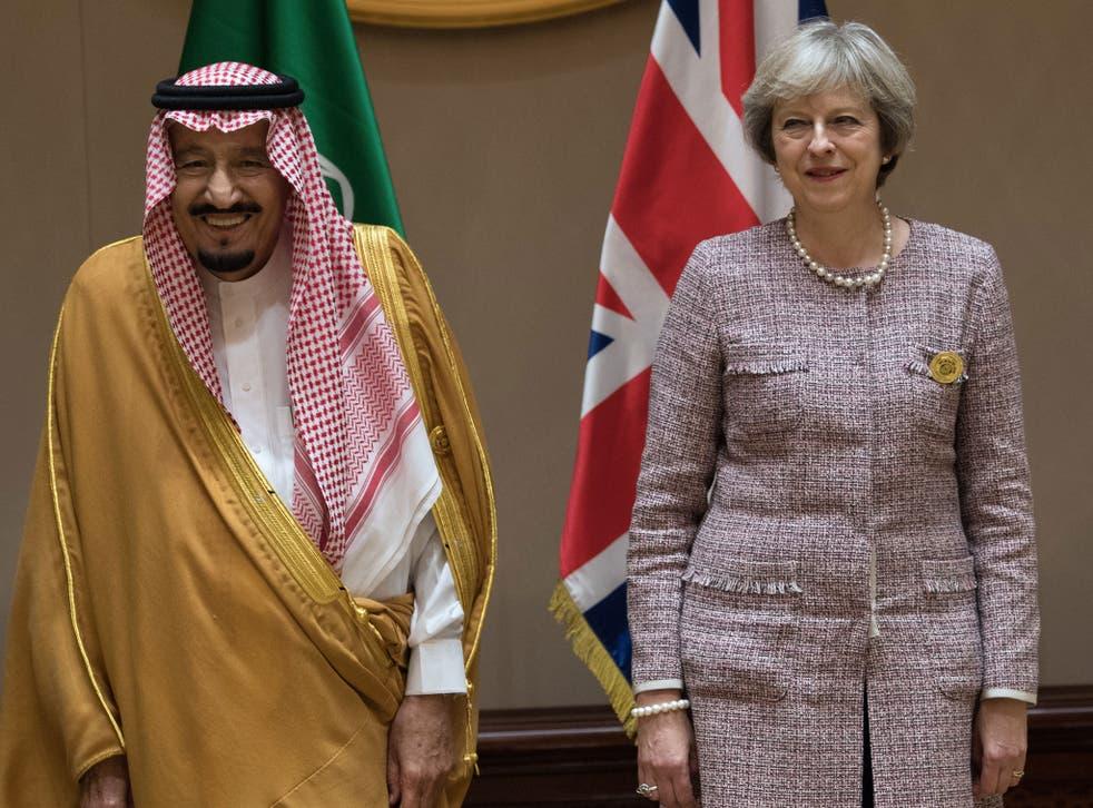 King Salman bin Abdulaziz of Saudi Arabia with Theresa May at the Gulf Cooperation Council summit in Bahrain in December