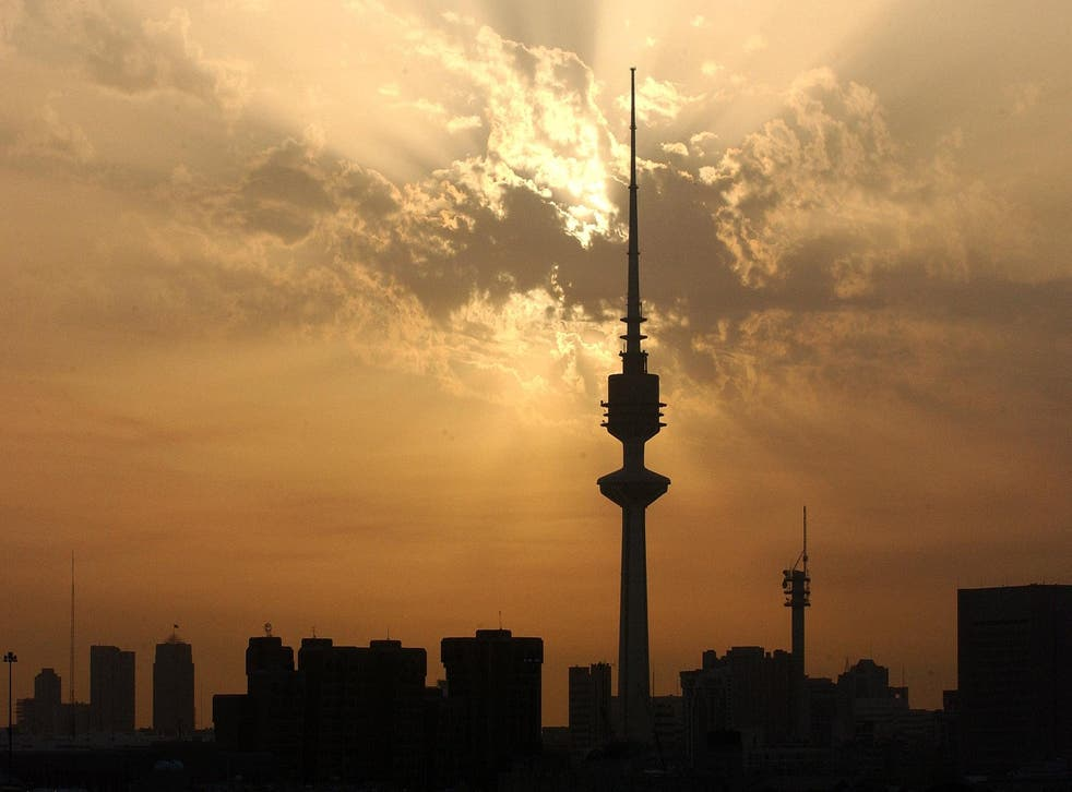 In this file picture, the sun sets on March 7, 2003 over the Kuwait City skyline. Most of the capital's rapid expansion has only been possible thanks to the labour of the Gulf State's estimated 2.9 million expatriate workers, who comprise roughly 70 per c