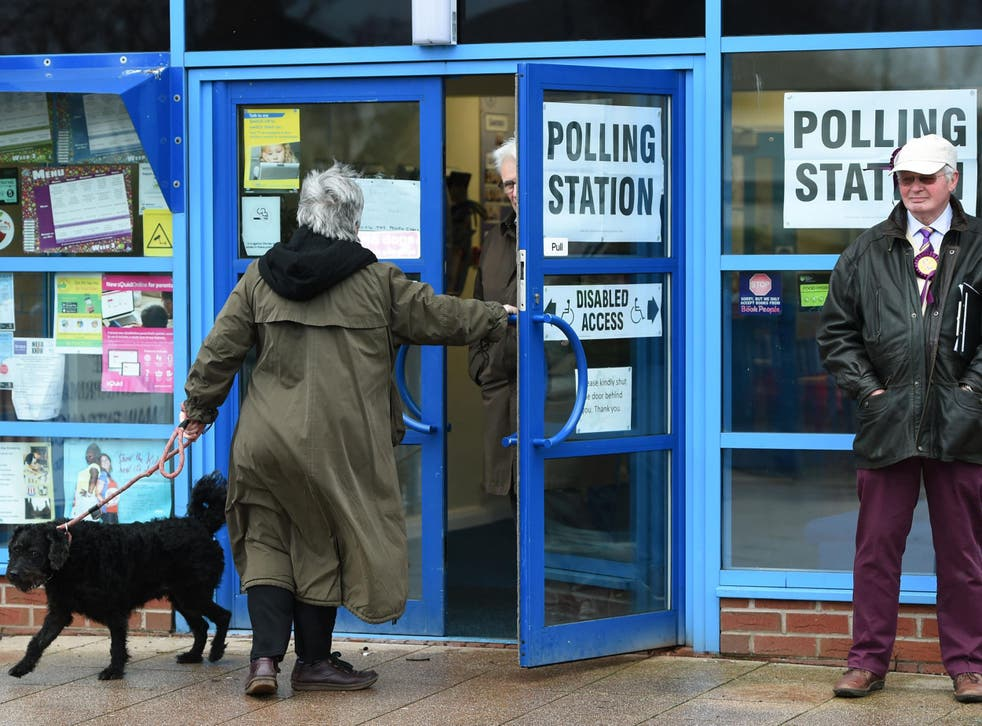 Voters arrive at The Willows Primary School polling station in Stoke as polling gets underway