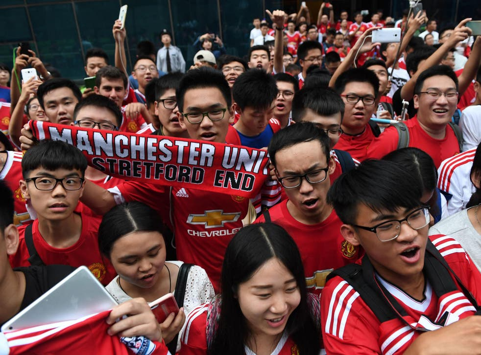 Manchester United fans in China wait for their heroes