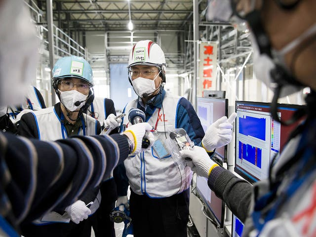 Workers of theTokyo Electric Power Co, which is tasked with the job to decommission the nuclear power plant in Okuma, Fukushima