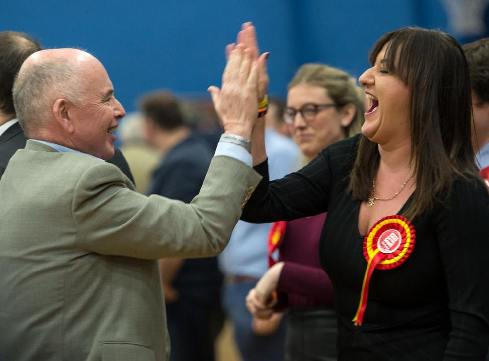 Labour MPs Jack Dromey and Ruth Smith celebrate their party's success in the Stoke-on-Trent Central constituency by-election