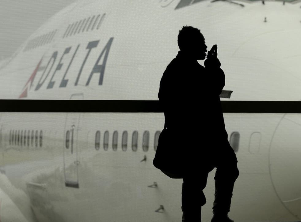 A Delta Air Lines flight that landed in New York was greeted by law enforcement officials who asked every passenger to show identification as they got off the plane. Here, a Delta airplane is shown in Detroit, in this file photo from 2012