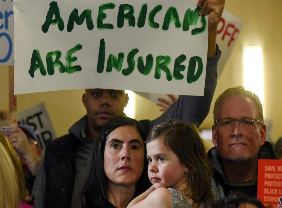 Obamacare supporters demonstrate against Donald Trump at a rally in New Jersey