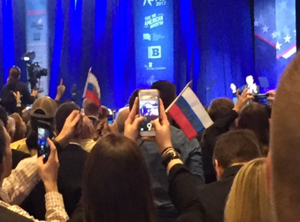 Supporters are seen waving Russian flags at CPAC conference