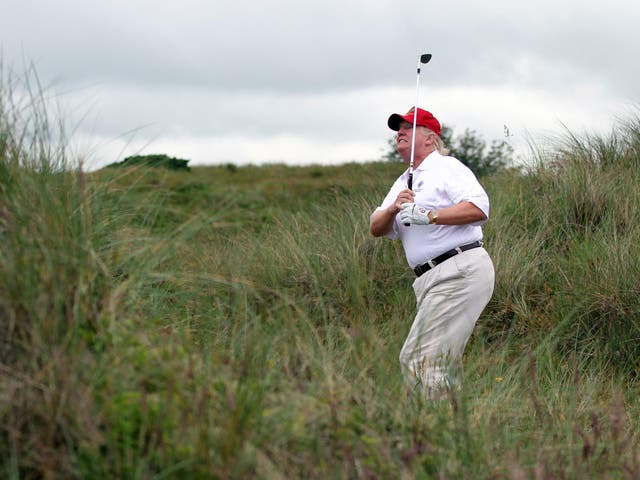 Donald Trump tees off at the The Trump International Golf Links Course in Balmedie, Scotland.