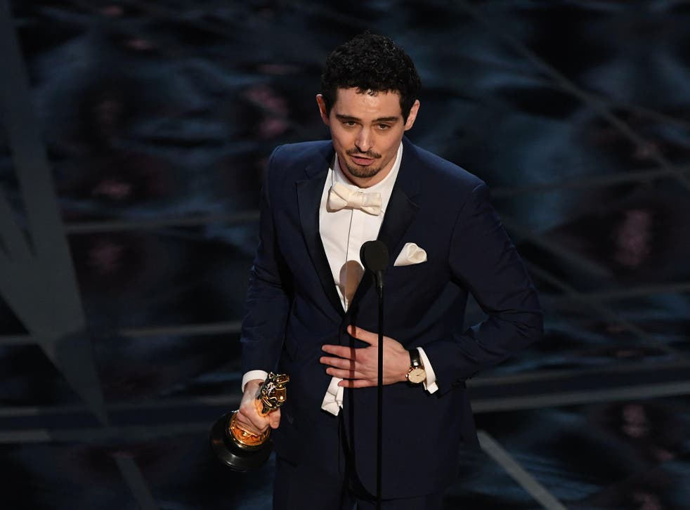 """Director Damien Chazelle delivers a speech on stage after he won the Best Director award for """"La La Land""""at the 89th Oscars"""