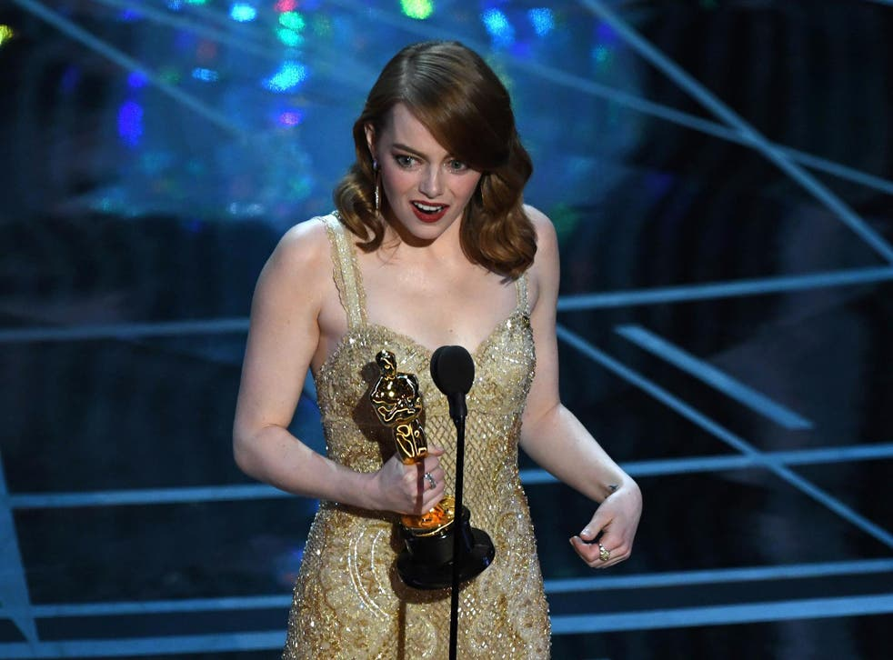 """Emma Stone delivers a speech on stage after she won the Best Actress award in """"La La Land"""" at the 89th Oscars"""