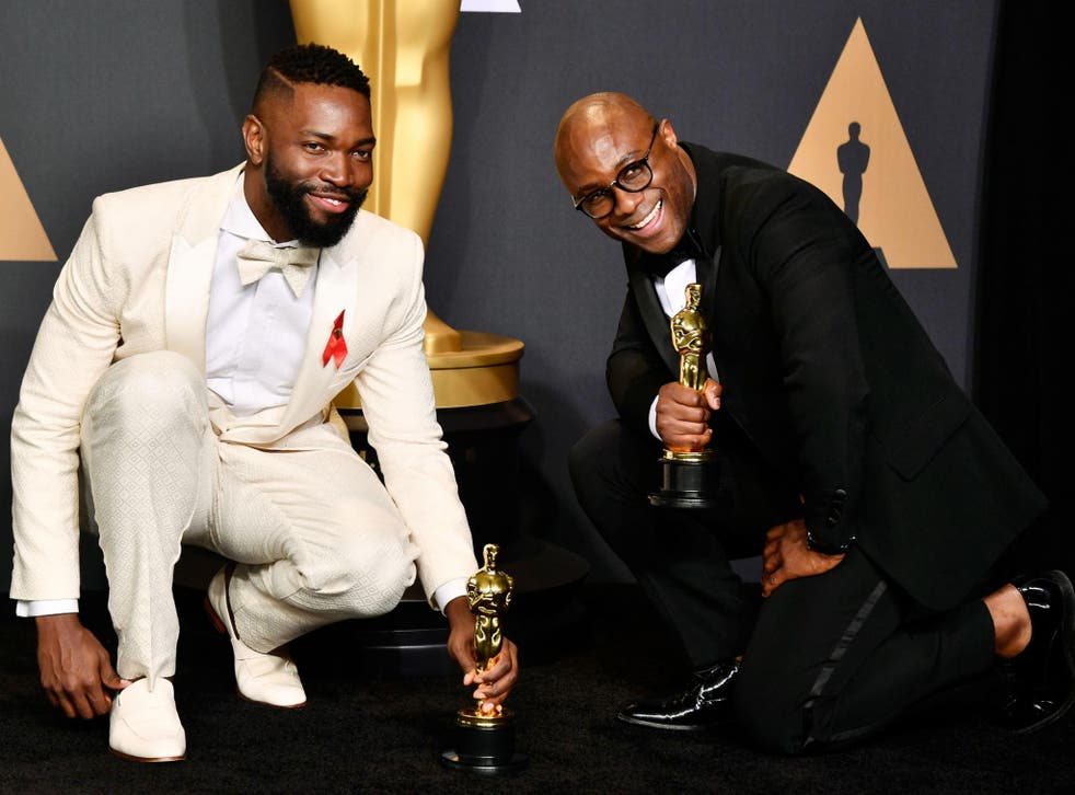 Tarell Alvin McCraney and Barry Jenkins celebrate winning Best Adapted Screenplay at the Oscars