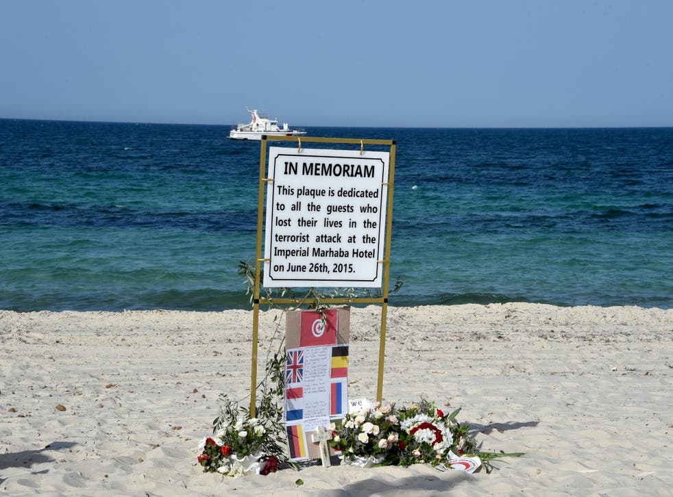 A memorial to the 38 people killed in the Sousse attack stands on the beach on the first anniversary of the attack