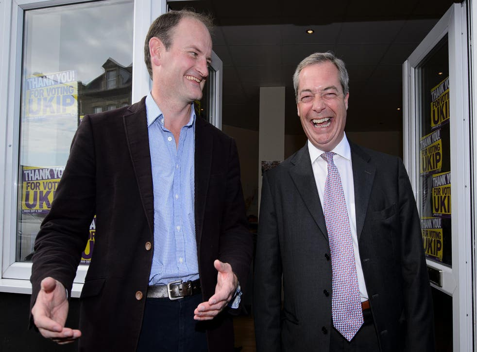 Ukip MP Douglas Carswell and Nigel Farage pose for pictures outside the party's local office in Clacton-on-Sea, in October 2014