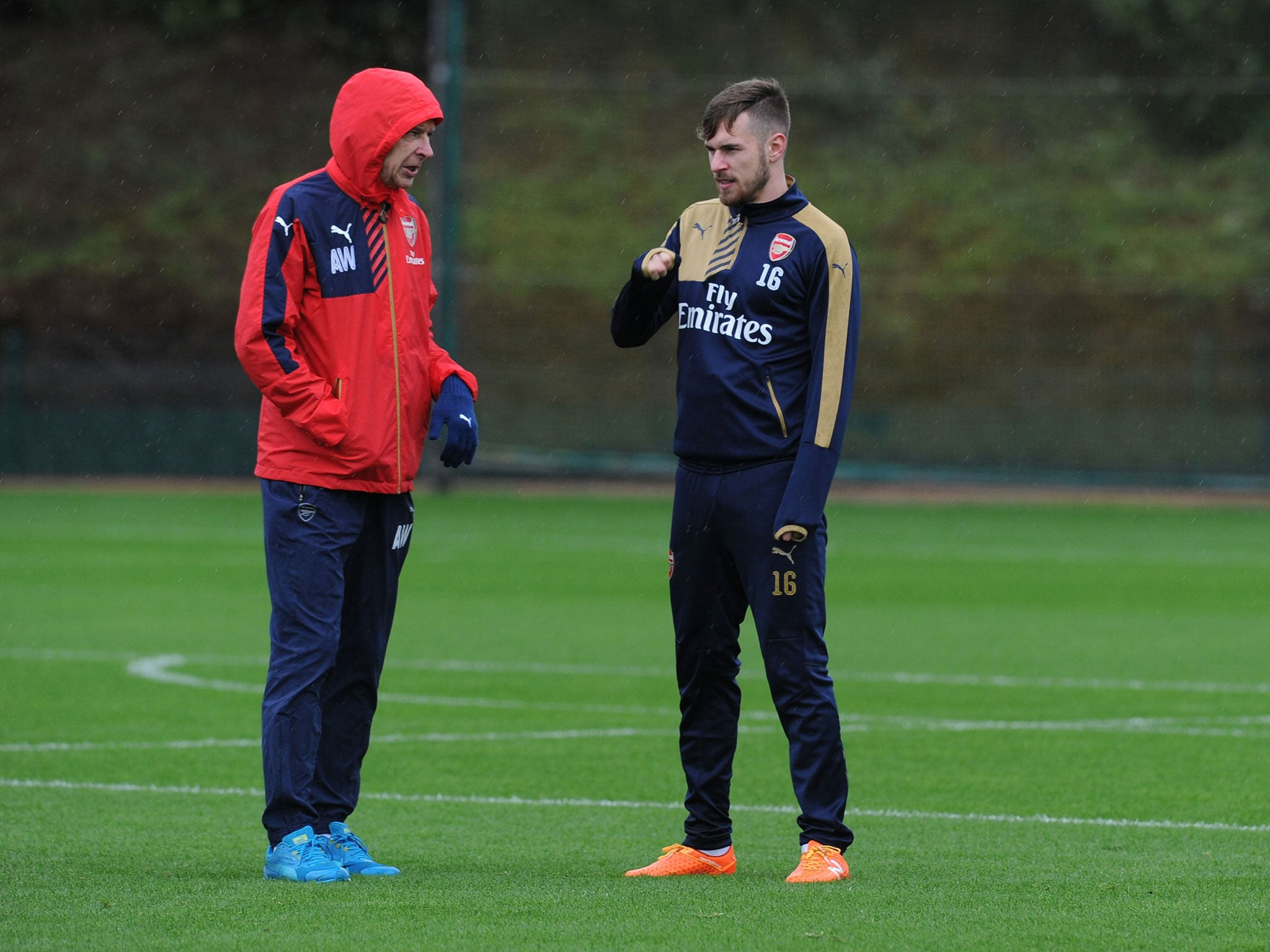 Arsenal's Aaron Ramsey defends Arsene Wenger against ...