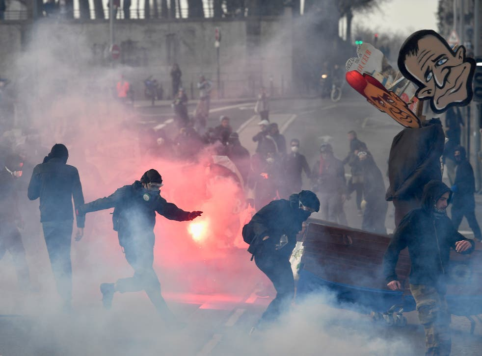Anti-establishment demonstrators protest ahead of a campaign rally by Front National leader Marine Le Pen in Nantes on Saturday