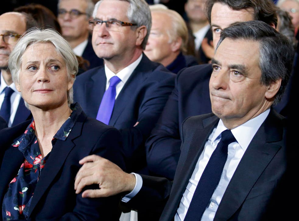 Francois Fillon (R) and his wife Penelope Fillon at political rally in Paris on 29 January