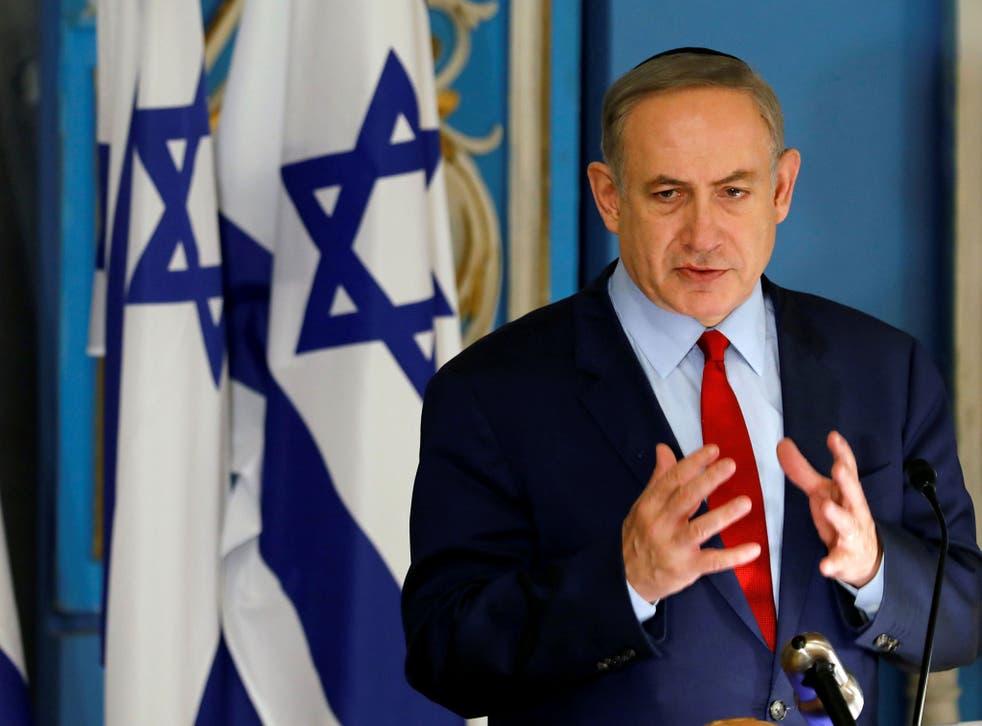 Israeli Prime Minister Benjamin Netanyahu speaks during an event marking International Holocaust Remembrance Day at the Yad Vashem synagogue in Jerusalem