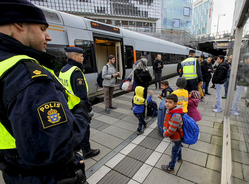 Police stand with refugee children in Sweden. The country has for years experienced the unique phenomenon of 'resignation syndrome'