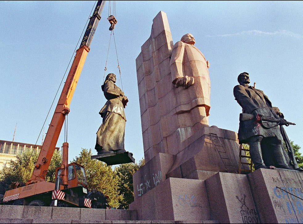 A crane manoeuvers a statue of a female worker away from the main Lenin monument in the newly named Liberty Square, formerly Lenin Square, in central Kiev.  Ukraine led the other Soviet republics in a move to secede from the Union