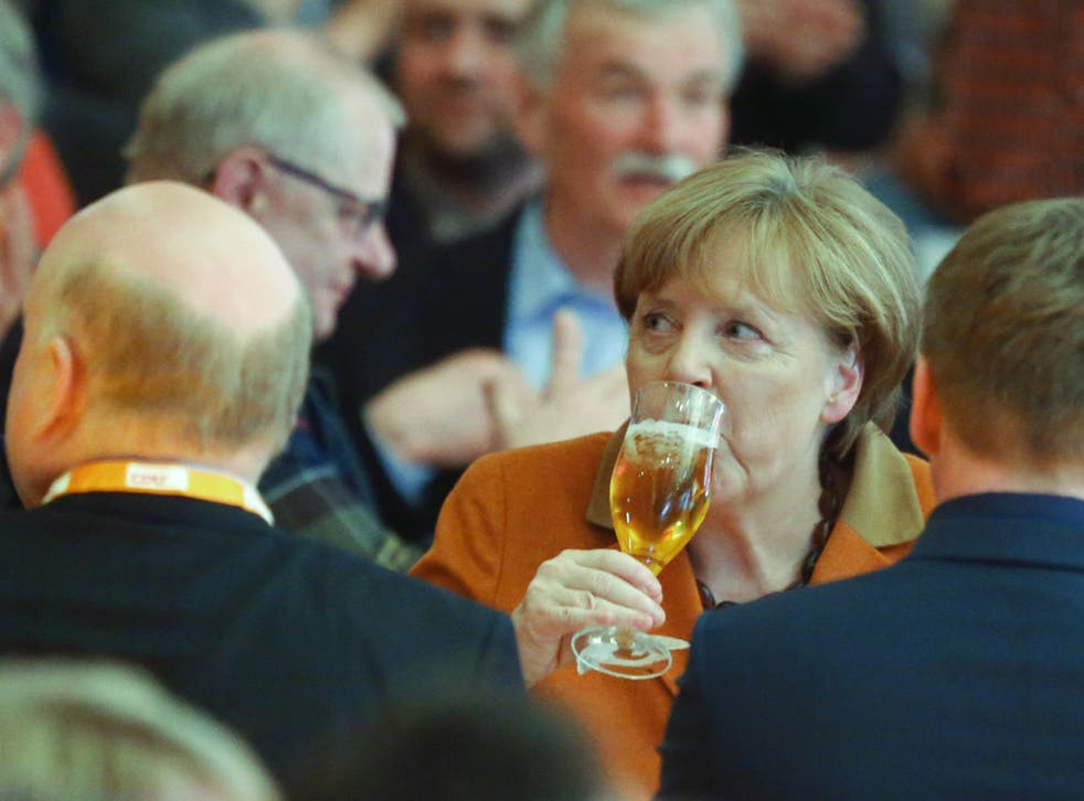 German Chancellor Angela Merkel drowns her sorrows during the political Ash Wednesday meeting of the Christian Democratic Union party in Demmin