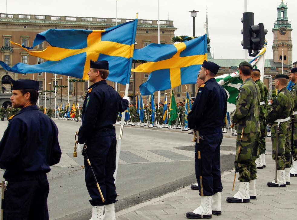 Swedish armed forces soldiers attend a rehearsal in front of the Royal Palace in Stockholm