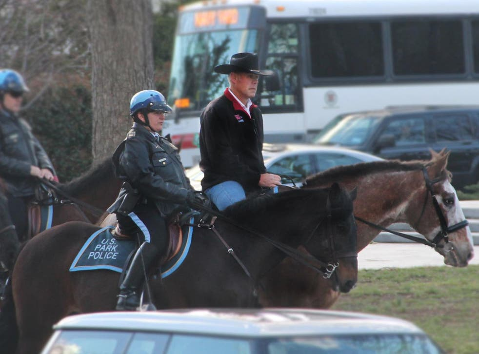 Interior Secretary Ryan Zinke arrives for work on horseback on his first day in the job