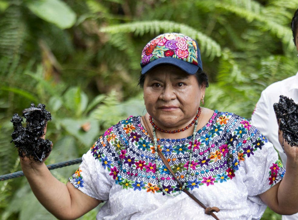 Nobel Peace Prize winner Rigoberta Menchu, an indigenous people's rights activist, shows her hands covered with oil during a protest in Lago Agrio in Ecuador near the site of oil exploration by Chevron's Texaco subsidiary