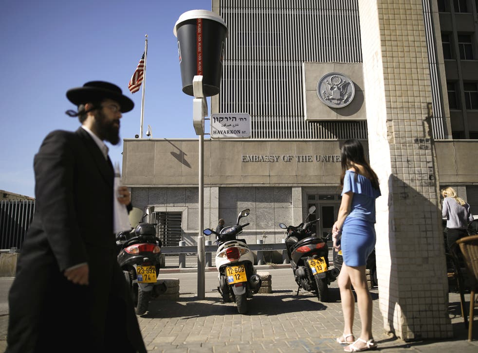 An ultra-Orthodox Jewish man walks by the US embassy in Tel Aviv, Israel
