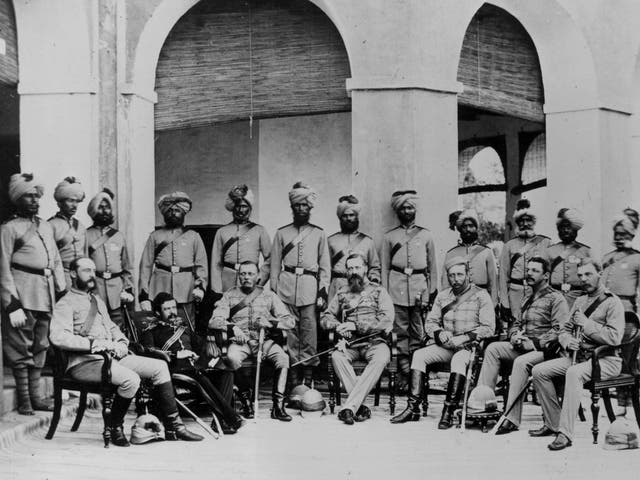 A group of British Frontier infantry soldiers with Indian soldiers lined up behind circa 1880