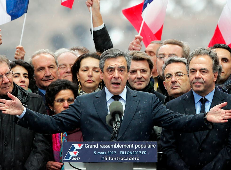 """French conservative presidential candidate Francois Fillon urges his supporters not to """"give up the fight"""" for the presidency during a rally in Paris."""