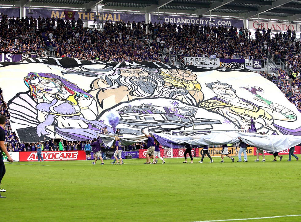 Orlando supporters unveil their banner, featuring a subtle tribute to the Pulse nightclub shooting victims