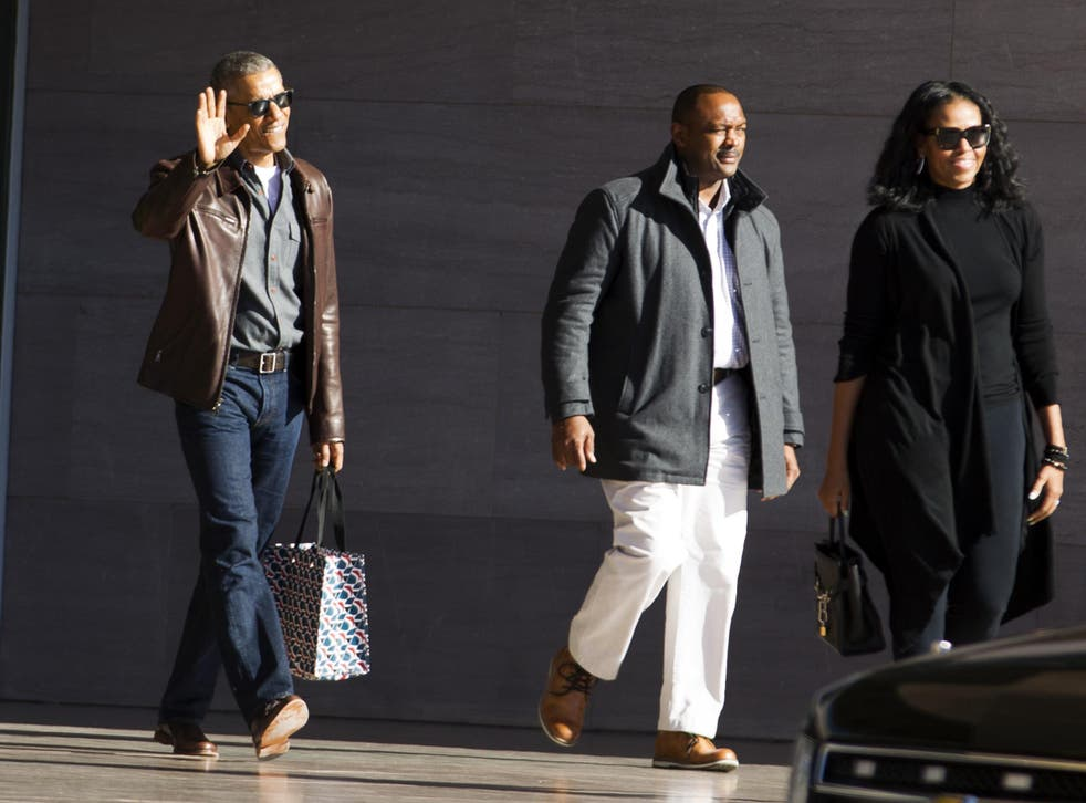 Obama wearing a brown leather jacket after leaving the National Gallery of Art in Washington, DC.