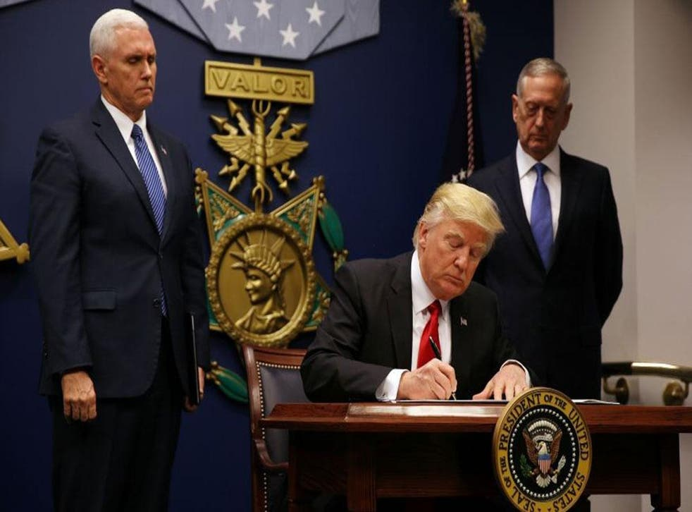 President Trump with Vice President Mike Pence (left) and James Mattis as he signs new order
